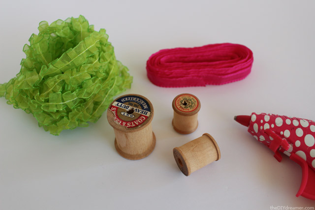 Use ribbon to decorate Wooden Spools