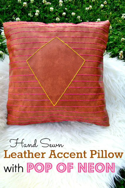 Hand sewn leather accent pillow using Neon colored embroidery floss