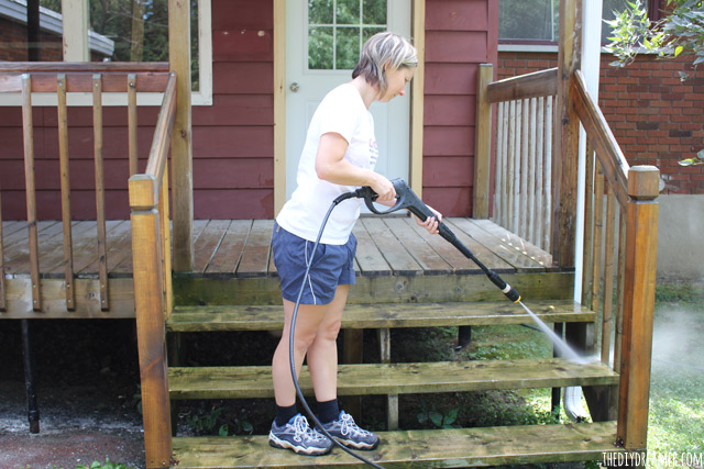 Pressure washer to clean a deck