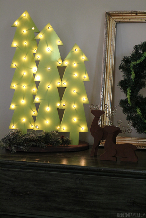 Wooden christmas trees with lights rustic