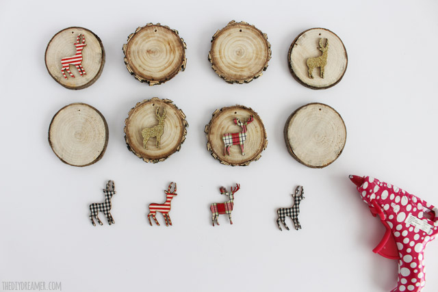 Hot glue woodland animals onto the wood slices