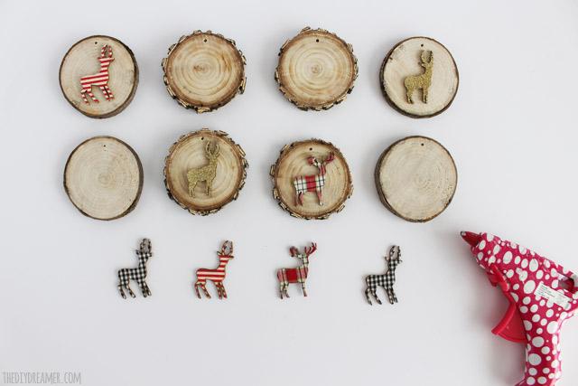 Hot glue woodland animals onto the wood slices