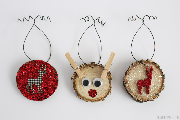 Wood Slice Ornaments - Kid Crafts! Oh so cute Christmas Ornaments made by a kid!