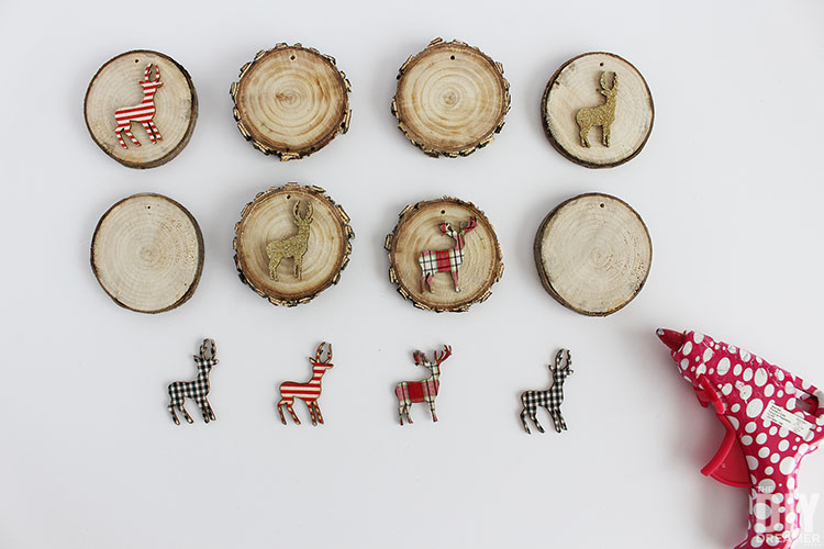 Hot glue woodland animals onto the wood slices.