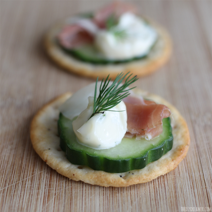 Looking for delicious hors d'oeuvres? Try these out! Cucumber, Prosciutto, Dill Mayo, and Dill topped crackers.