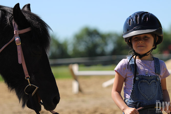 Proud Child showing a horse.