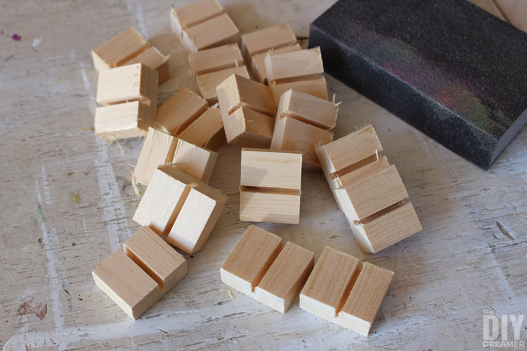 Sanding small pieces of wood with a sanding block.