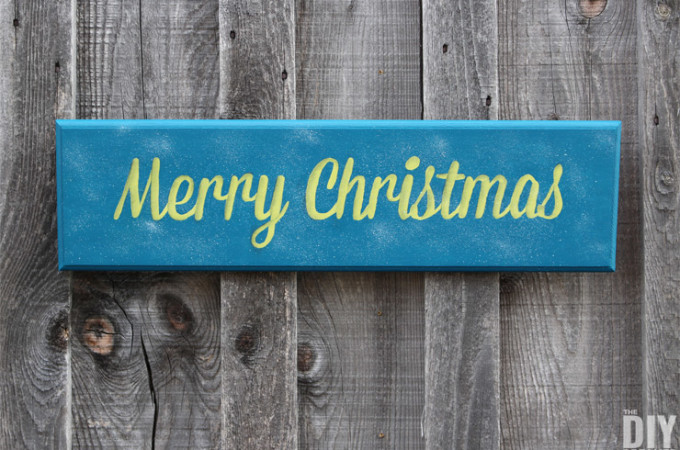 Hand painted wooden Merry Christmas wall plaque sign. This is part 1 of a two part Merry Christmas sign DIY tutorial. Part 1 explains how to make the Merry Christmas sign and Part 2 demonstrates how to go from a pretty sign to a STUNNING Merry Christmas sign! Click through for the tutorial: thediydreamer.com