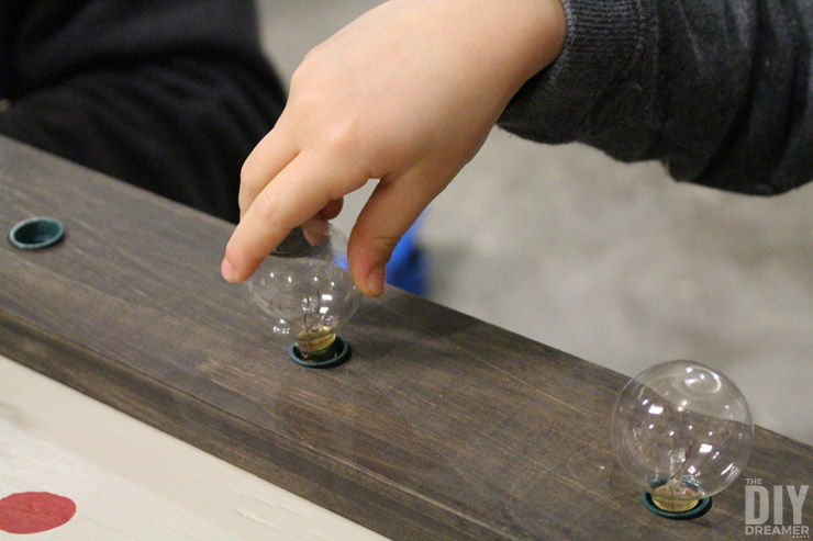 Screwing in the light bulbs