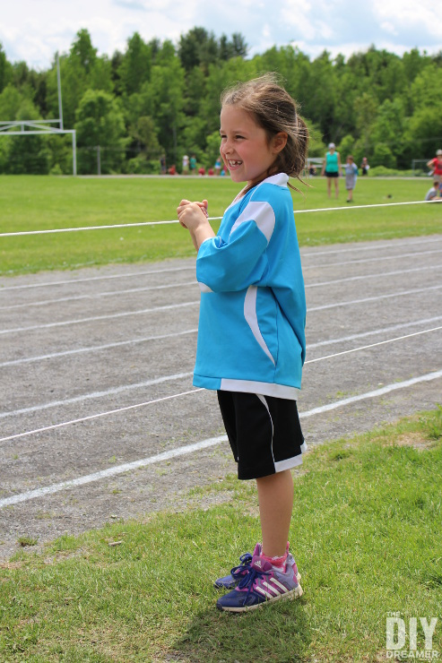 Cheering on teammates during track and field meet.