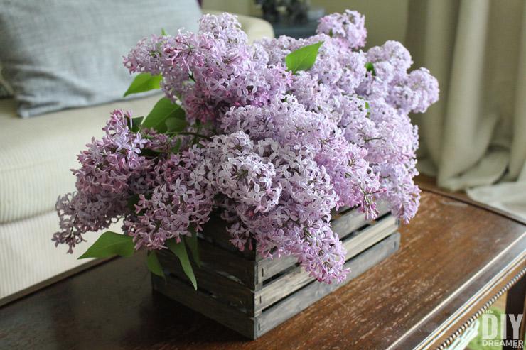 Beautiful DIY Paint Stick Flower Basket. Learn how to build a flower basket using paint sticks. thediydreamer.com