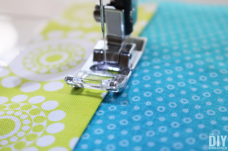 Sewing fabric together to make fabric bookmarks
