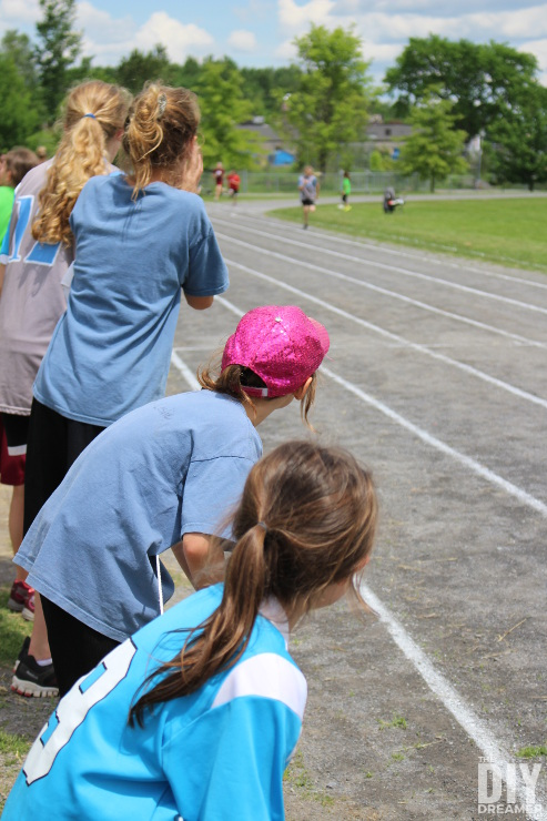 Cheering on teammates during the track and field meet.