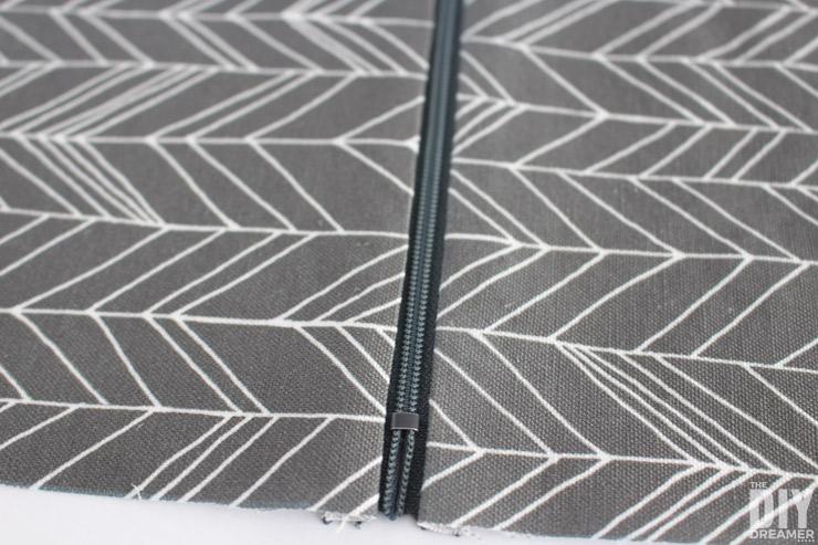 Press fabric close to zipper