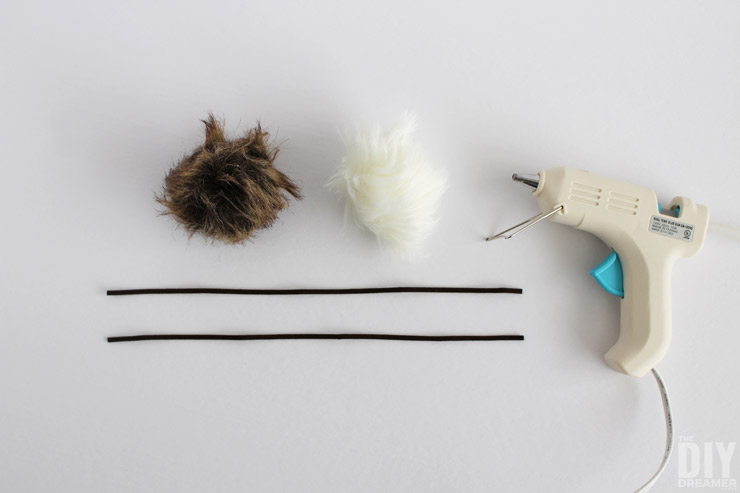 How to attach sueded cording to a fur pom pom.