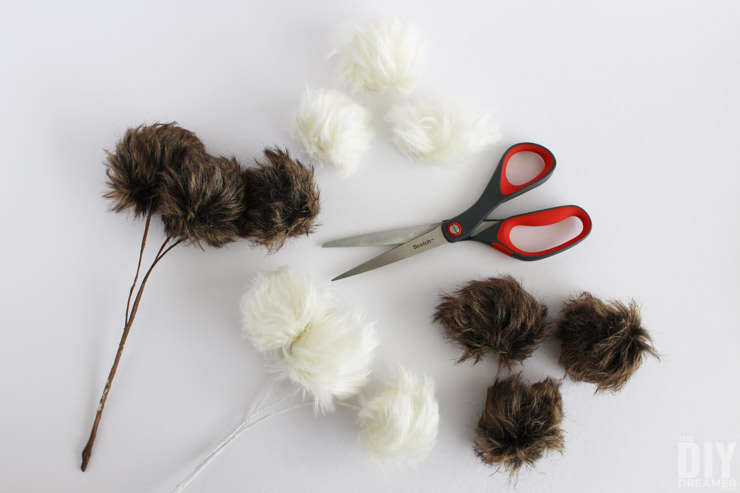 Cut pom poms off the branch picks.
