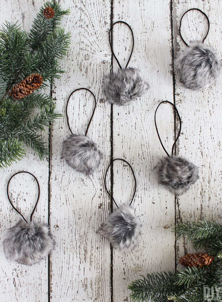 Add a fun touch of rustic to your Rustic Christmas with these DIY Faux Fur Pom Pom Christmas Ornaments! Also perfect for a Woodland Christmas theme!