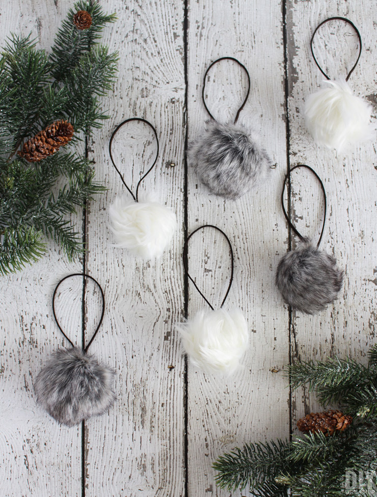 Add a fun touch of rustic to your Rustic Christmas with these DIY Faux Fur Pom Pom Christmas Ornaments!