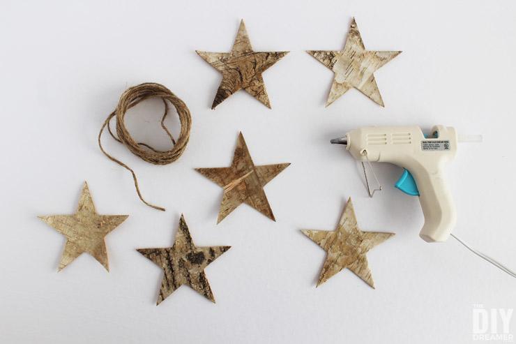 Glue birch stars onto string of twine