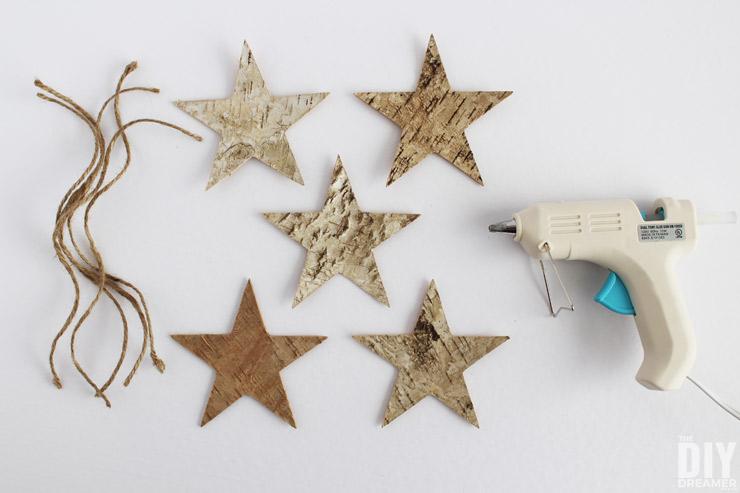 Glue twine onto back of the birch stars