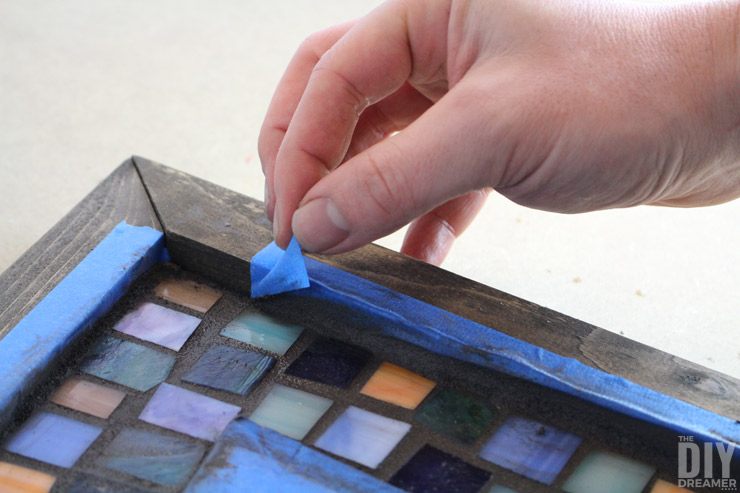 Remove painter's tape as soon as you are done grouting.