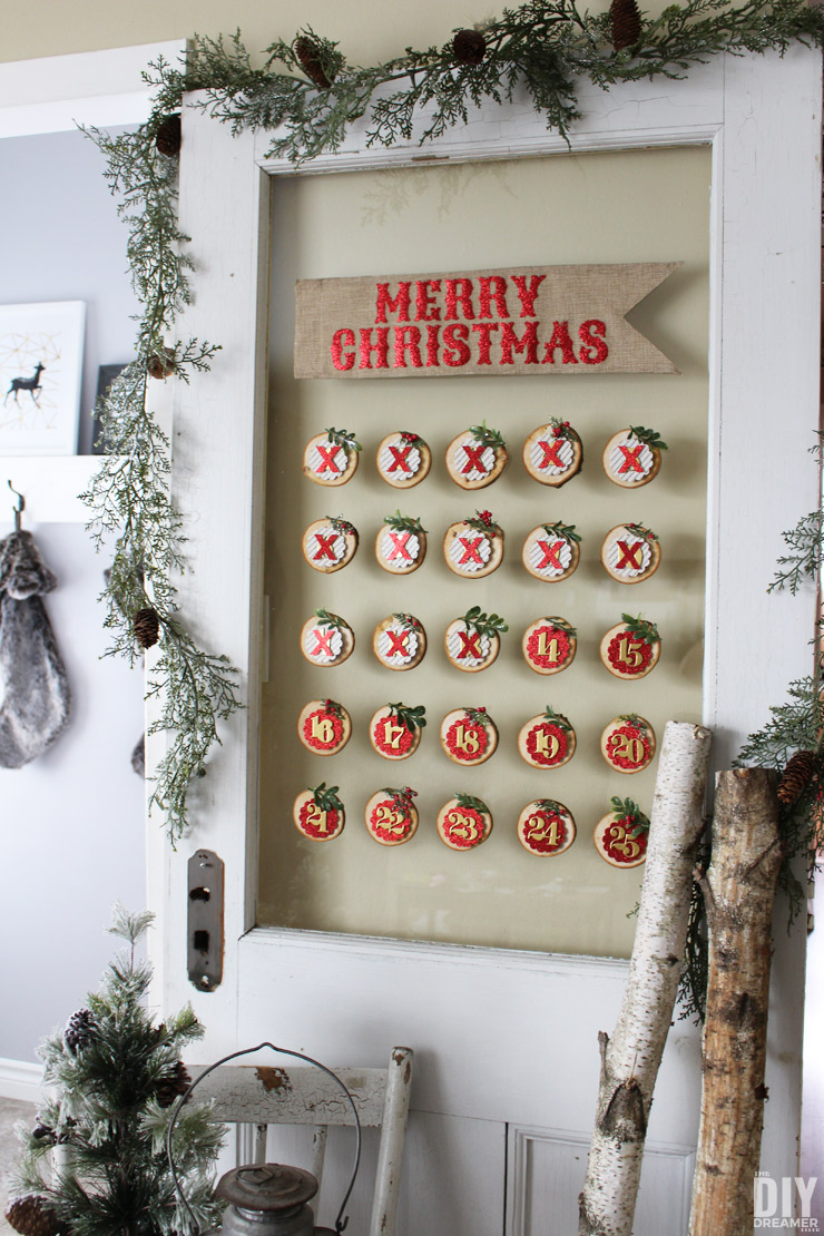 Glass Mounted Christmas Countdown. This wood slice Christmas Countdown can be used year after year. A beautiful way to countdown to Christmas. A fun DIY Christmas Countdown project!