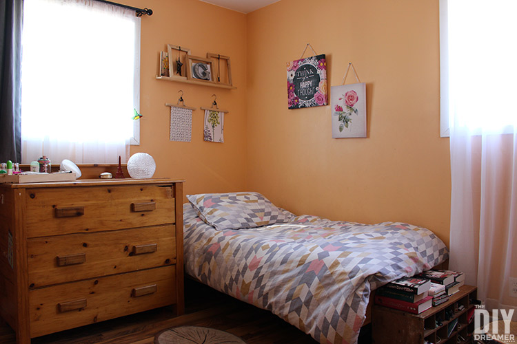 Teen bedroom painted in bright orange before the bedroom makeover.