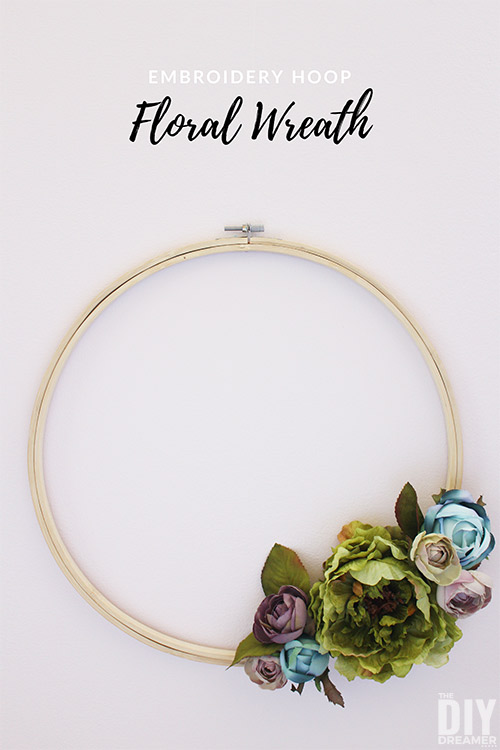 DIY Floral Embroidery Hoop Wreath. Quick and easy to make! They are perfect to decorate doors and walls too. Imagine a cluster of hoop wreaths decorating a wall, that would make stunning wall art!