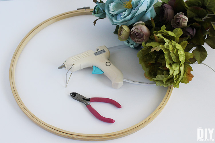 Supplies needed to make an embroidery hoop wreath with flowers