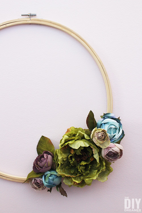 Make stunning wall art with a cluster of embroidery hoop wreaths.