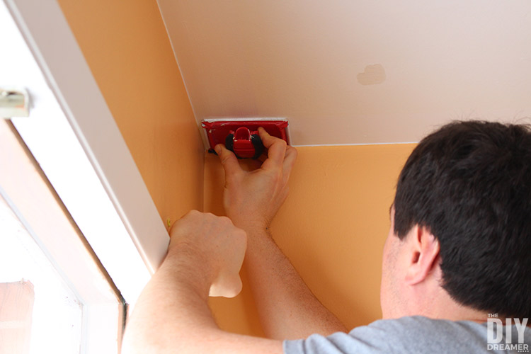 To paint a ceiling start by using a paint edger to paint the contour of the surface.
