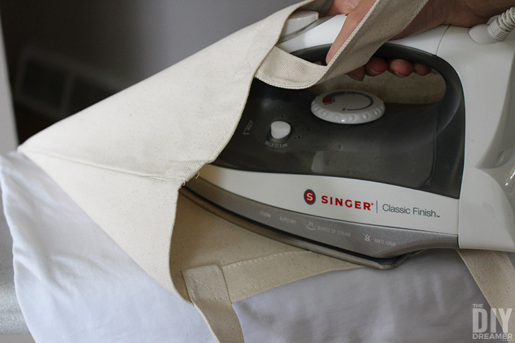 How to press an iron-on transfer onto a tote bag