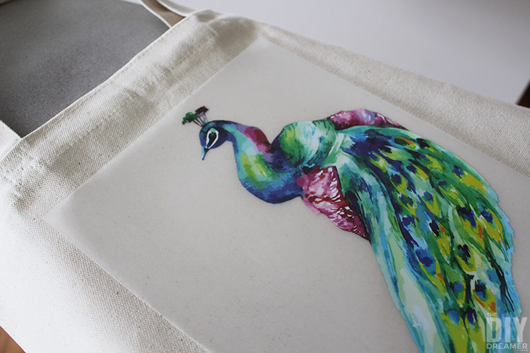 Place the iron-on transfer paper on the desired location