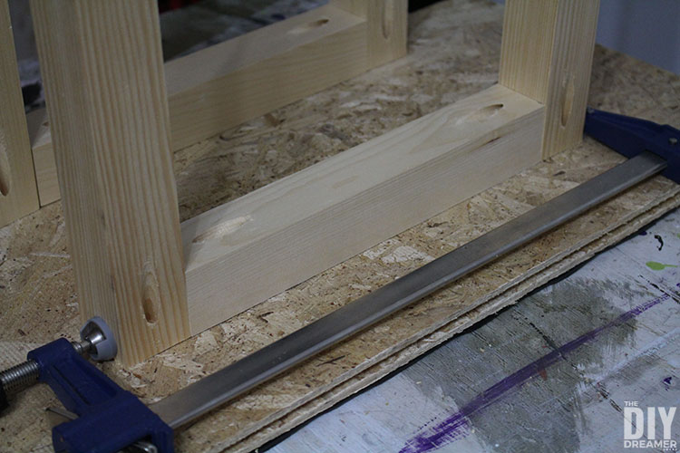 Use clamps to attach legs together then use screws to fasten together