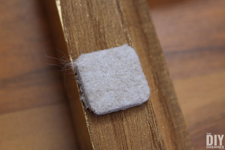 Place felt furniture pads behind things that may scratch a wall