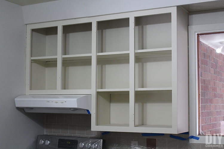 Upper cabinets painted in off-white.