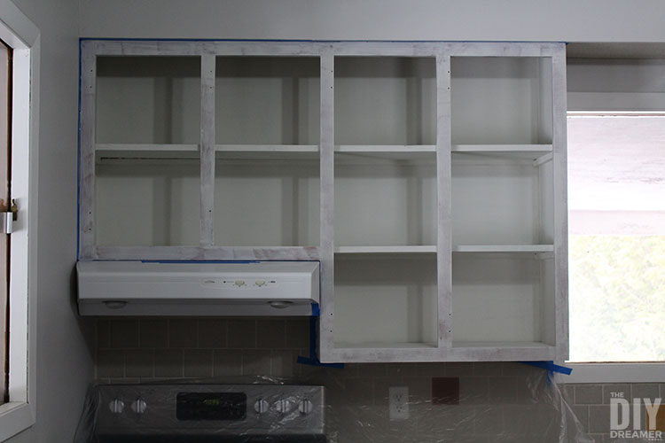 Upper cabinets with primer.