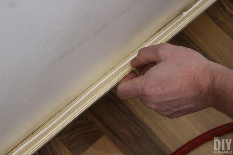 Glue wood plank to wall.