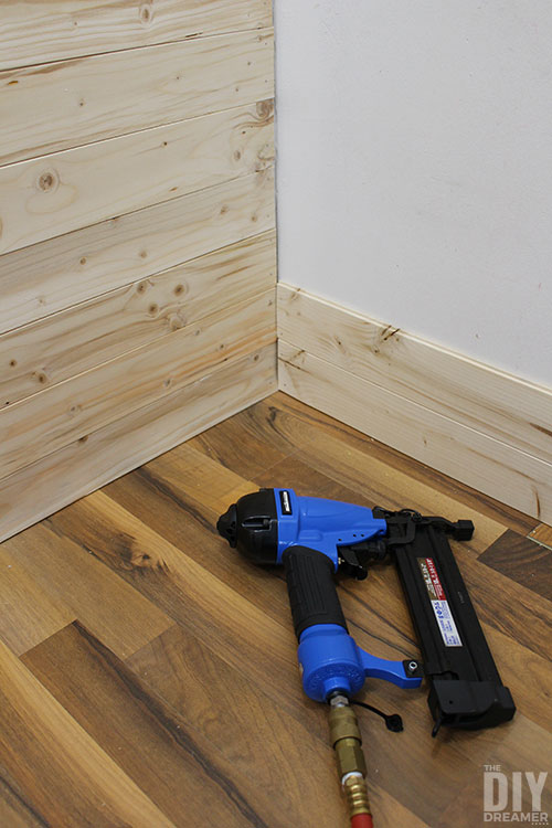 Installing wood planks in a closet.