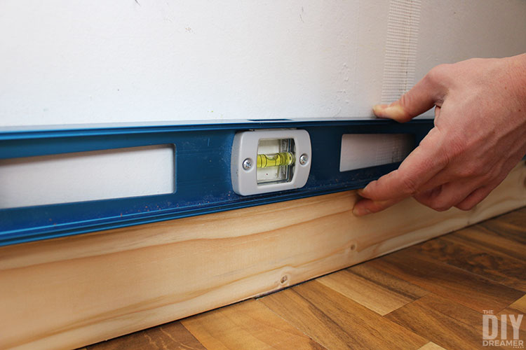 Make sure first wood plank installed is level.