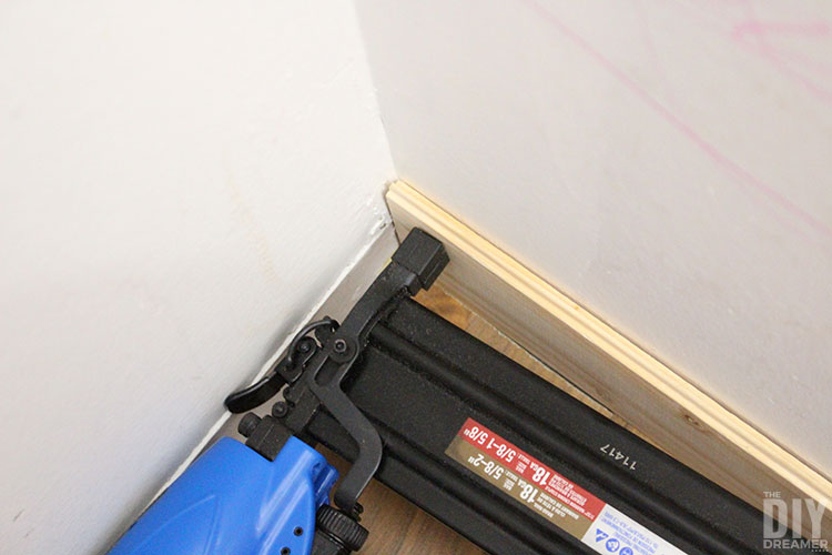 Use nail fun to attach plank to wall.