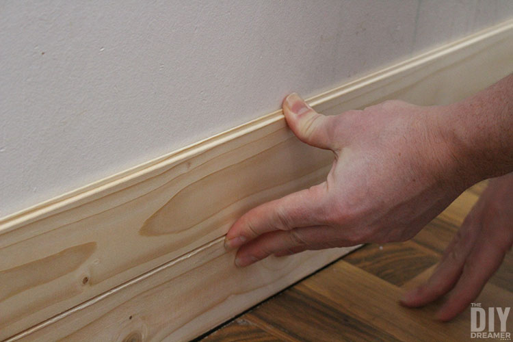 Press planks to wall for them to stick in place.
