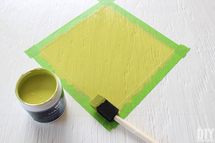 Paint barn quilt using a foam brush.