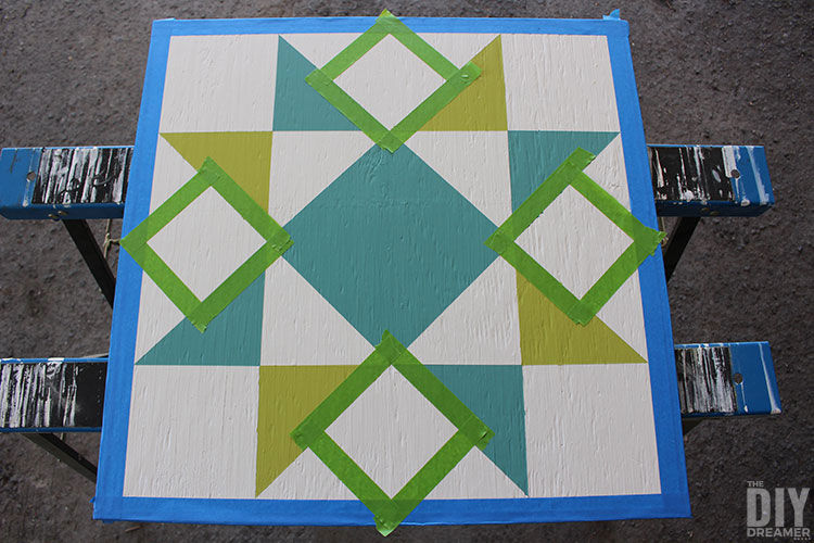 Add more colors to barn quilt.