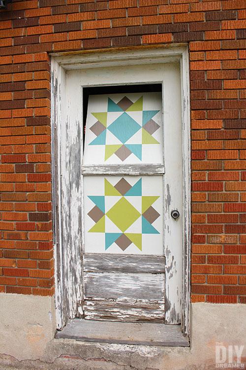 Installing barn quilt in a door.