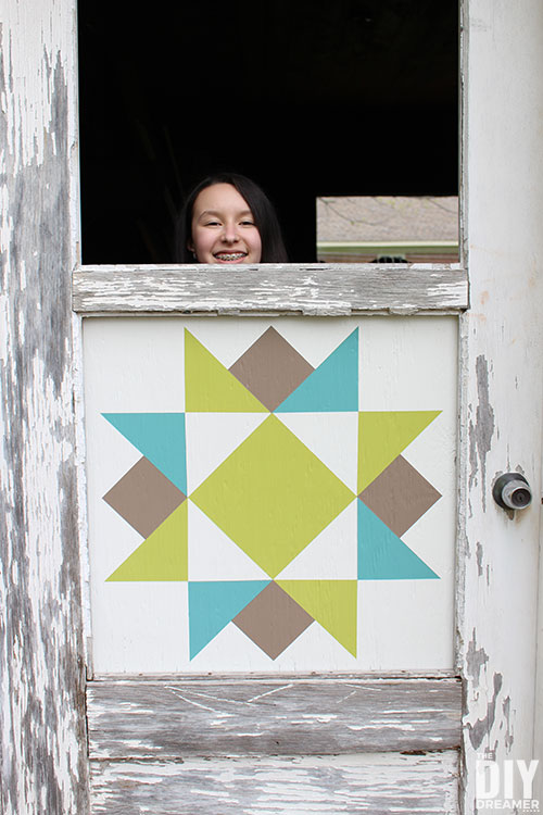 Installing barn quilts into a door.