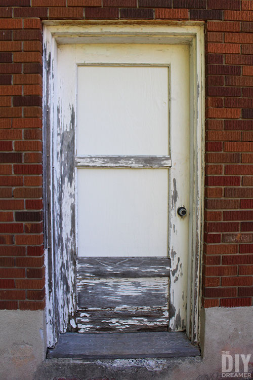 Old weathered door with painted windows.