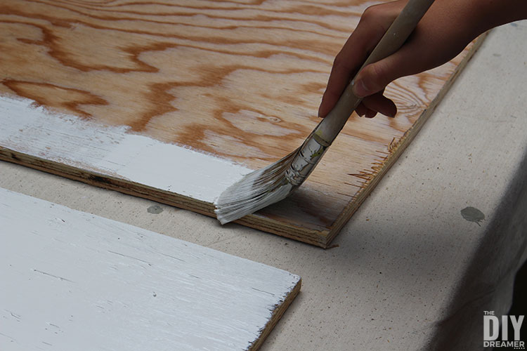 Paint plywood in light color to make the barn quilt pop.