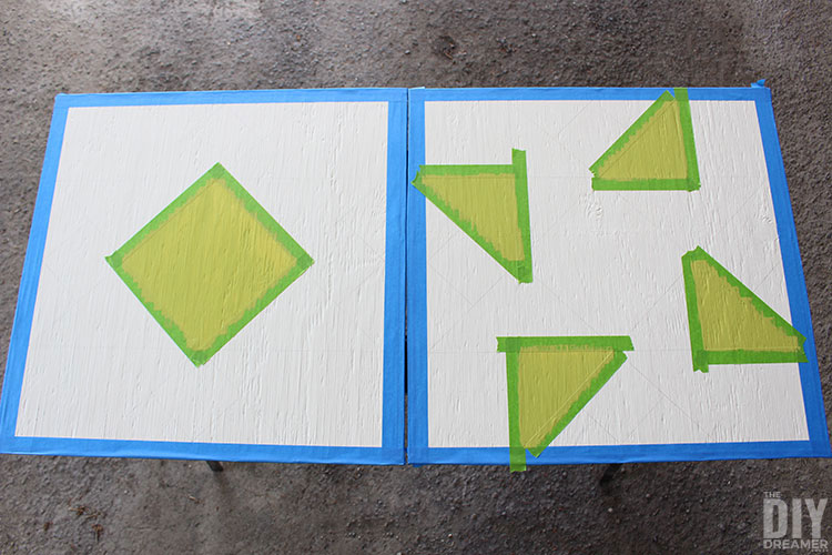 Paint barn quilt shapes using painters tape and foam brush.