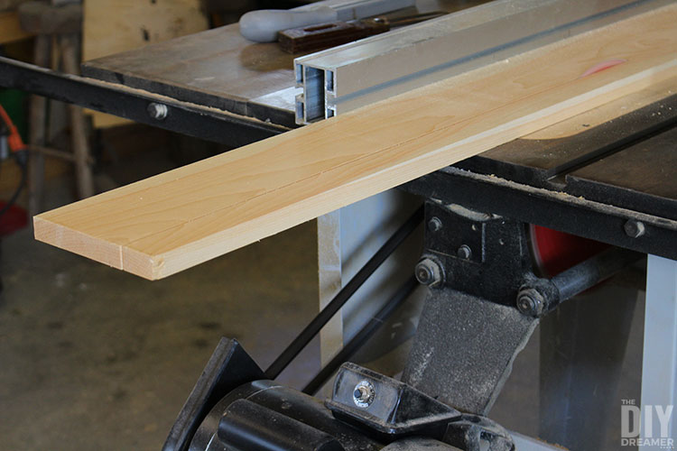 Cut wood boards with a table saw.